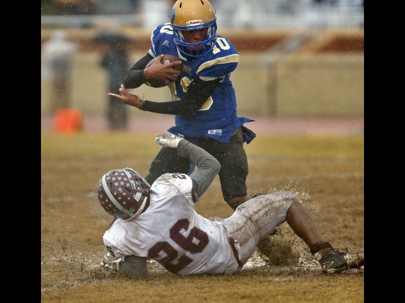 Phoebus' Chris Daniels attempts to avoid the tackle of Norcom's Teon Garland during Saturday afternoon's Class 3 Region A championship game at Darling Stadium November 24, 2018. (Jonathon Gruenke)